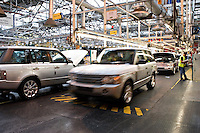 Manufacturing workers building Land Rover Range Rover vehicle at Solihull plant Birmingham UK.