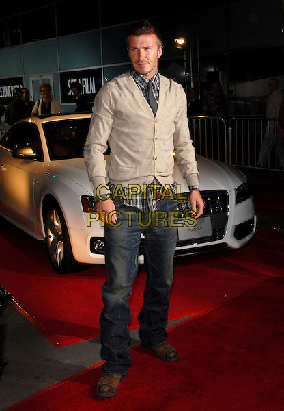 DAVID BECKHAM .Attends The AFI Film Festival Screening of Lions for Lambs held at The Cinerama Dome in Hollywood, California on .November 1st, 2007  .full length jeans denim beige cardigan                                                                 .CAP/DVS.©Debbie VanStory/Capital Pictures