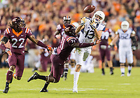 Landover, MD - SEPT 3, 2017: A pass is broken up by Virginia Tech Hokies safety Reggie Floyd (21) against West Virginia Mountaineers wide receiver David Sills V (13) during game between West Virginia and Virginia Tech at FedEx Field in Landover, MD. (Photo by Phil Peters/Media Images International)