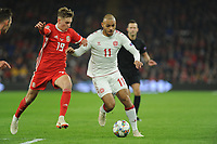 David Brooks of Wales battles with Martin Braithwaite of Denmark during the UFEA Nations League B match between Wales and Denmark at The Cardiff City Stadium in Cardiff, Wales, UK. Friday 16 November 2018