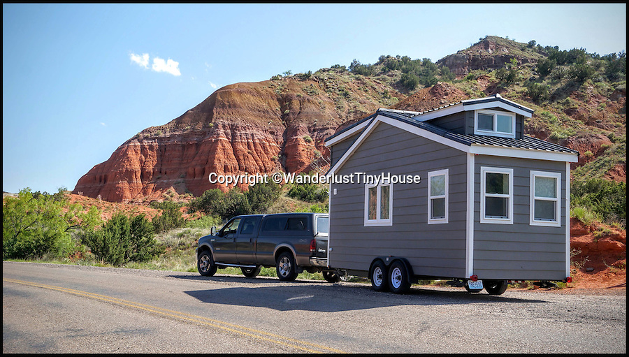 BNPS.co.uk (01202 558833)<br /> Pic: WanderlustTinyHouse/BNPS<br /> <br /> Driving into Palo duro canyon.<br /> <br /> Wanderlust for homebird's -  a young couple have solved the problem of leaving a much loved home to go travelling, by strapping a downsized version to the back of their pick-up and taking it with them.<br /> <br /> Patrick Howard and Lauren Kennedy ditched their office jobs, sold most of their worldly possessions and their 2,000 sq ft home and bought the miniscule 200 sq ft house, which can be towed by a pick-up truck.<br /> <br /> The pair, who were both electrical engineers, are now on their trip of a lifetime travelling all over the United States with their two dogs, Otis and Colbie.<br /> <br /> They are part of the Tiny House Movement - a growing group of people who are buying small houses and enjoying simpler lives.