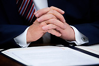 US President Donald J. Trump prepares to sign 'H.R. 724, the Preventing Animal Cruelty and Torture Act', in the Oval Office of the White House in Washington, DC, USA, 25 November 2019.<br /> Credit: Michael Reynolds / Pool via CNP/AdMedia