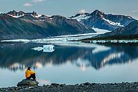 Summer landscape of man viewing icebergs at Bear Glacier Lagoon in Kenai Fjords National Park.  Kenai Penninsula, Summer, Alaska   <br /> <br /> Photo by Jeff Schultz/  (C) 2019  ALL RIGHTS RESERVED