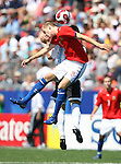 22 July 2007: Czech Republic's Marek Strestik (in red) challenges Argentina's Gabriel Mercado (behind) for a header. At the National Soccer Stadium, also known as BMO Field, in Toronto, Ontario, Canada. Argentina's Under-20 Men's National Team defeated the Czech Republic's Under-20 Men's National Team 2-1 in the championship match of the FIFA U-20 World Cup Canada 2007 tournament.