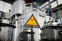 A warning sign in place as highly enriched uranium (HEU) is loaded into casks at the Institute of Nuclear Physics in Almaty. The removal of Kazakhstan's HEU is part of the U.S. Global Threat Reduction Initiative (GTRI) which tries to secure nuclear material around the world to prevent their misuse.
