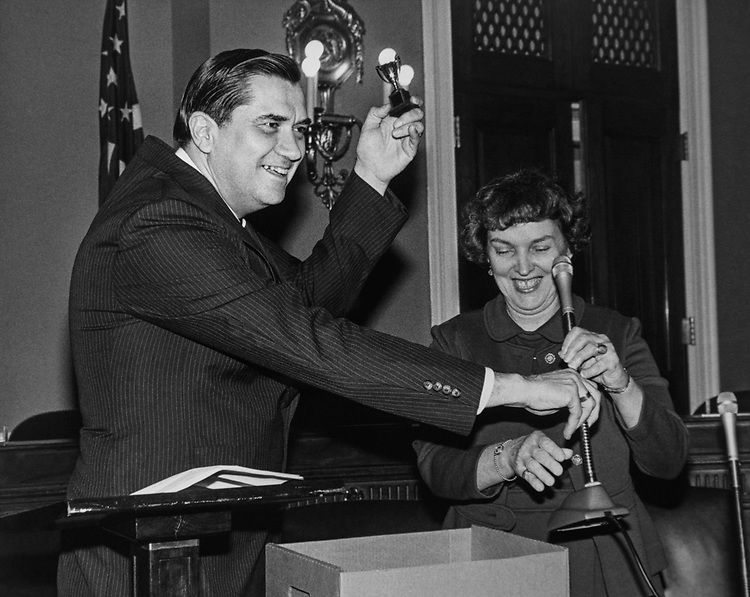 Congressional aide Hyde Murray holding Trophy and handing over the microphone at the Rayburn House Office Building. (Photo by CQ Roll Call via Getty Images)