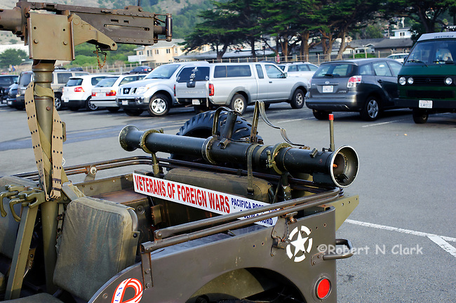 Military Jeep in public parking lot at the Pacific beach
