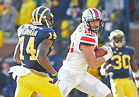 Ohio State Buckeyes tight end Jeff Heuerman (86) slips past Michigan Wolverines safety Josh Furman (14) for a second half touchdown at Michigan Stadium in Ann Arbor, Michigan on November 30, 2013.  (Chris Russell/Dispatch Photo)