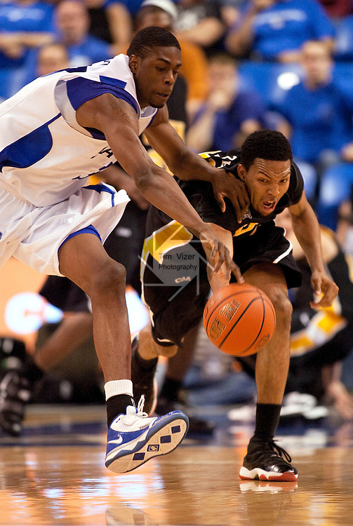 March 31,  2010               Virginia Commonwealth guard Brandon Rozzell (32, right) and Saint Louis forward Willie Reed (33) both dive for a loose ball in the second half.    The Virginia Commonwealth University Rams won the best-of-three games Championship Series of the College Basketball Invitational Tournament by defeating Saint Louis University 71-65 in game two on Wednesday March 31, 2010 at SLU's Chaifetz Arena, near downtown St. Louis.