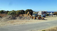 Pictured: A digger loads soil to a tipper lorry from the new site to be taken to the farmhouse in order to be searched in Kos, Greece. Sunday 09 October 2016<br />