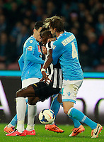 Calcio, Serie A: Napoli vs Juventus. Napoli, stadio San Paolo, 30 marzo 2014. <br /> Juventus midfielder Paul Pogba, of France, center, is challenged by Napoli forward Jose' Maria Callejon, of Spain, partially seen at left, and defender Adriano Buss Henrique, of Brazil, during the Italian Serie A football match between Napoli and Juventus at Naples' San Paolo stadium, 30 March 2014. Napoli won 2-0.<br /> UPDATE IMAGES PRESS/Isabella Bonotto