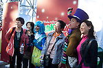 Park guests pose with the Whos in Whoville at Grinchmas at Universal Studios Hollywood in Los Angeles, CA