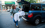 Julie Linford of Outcast Cat Help of Martinez carries a blanket covered trap to a location to return a previously trapped cat that has now been spayed/neutered and vaccinated to its' outside home area in Antioch, California on Saturday, March 22, 2014.  Photo/Victoria Sheridan