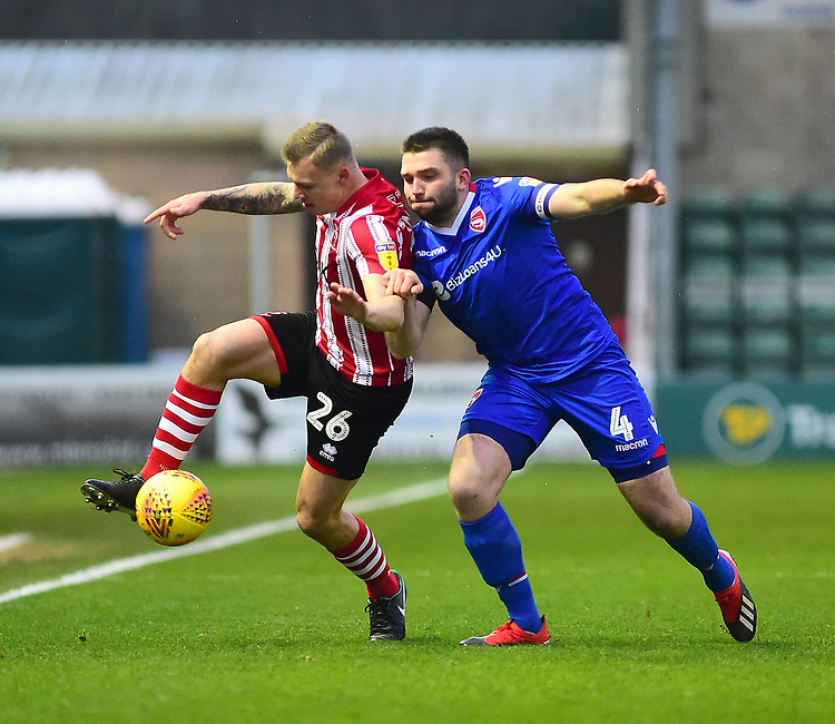 Lincoln City's Harry Anderson vies for possession with Morecambe's Alex Kenyon<br /> <br /> Photographer Andrew Vaughan/CameraSport<br /> <br /> The EFL Sky Bet League Two - Saturday 15th December 2018 - Lincoln City v Morecambe - Sincil Bank - Lincoln<br /> <br /> World Copyright © 2018 CameraSport. All rights reserved. 43 Linden Ave. Countesthorpe. Leicester. England. LE8 5PG - Tel: +44 (0) 116 277 4147 - admin@camerasport.com - www.camerasport.com