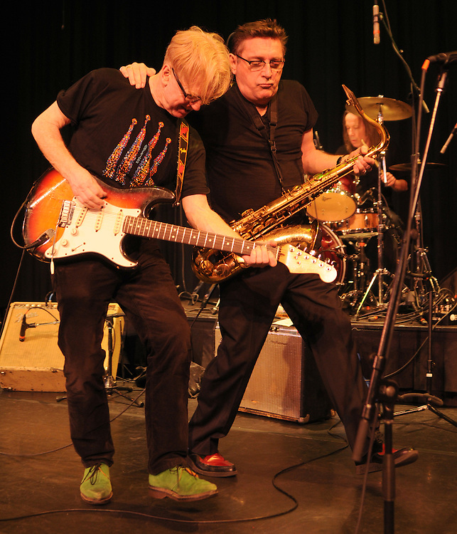 Left to right: Larry Kirwan (Vocals, Stratocaster), and Geoff Blythe (Saxophone), jamming during a performance at the Boulton Center in Bay Shore, Long Island, on Friday, March 4, 2011. Photograph by Jim Peppler. Copyright Jim Peppler/2011.