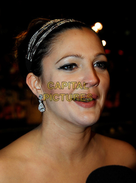 "DREW BARRYMORE.At the UK Film Premiere of ""Music & Lyrics"",.Odeon Leicester Square, London, England,.February 5th 2007..portrait headshot hairband hair band earrings mouth open.CAP/IA.©Ian Allis/Capital Pictures"