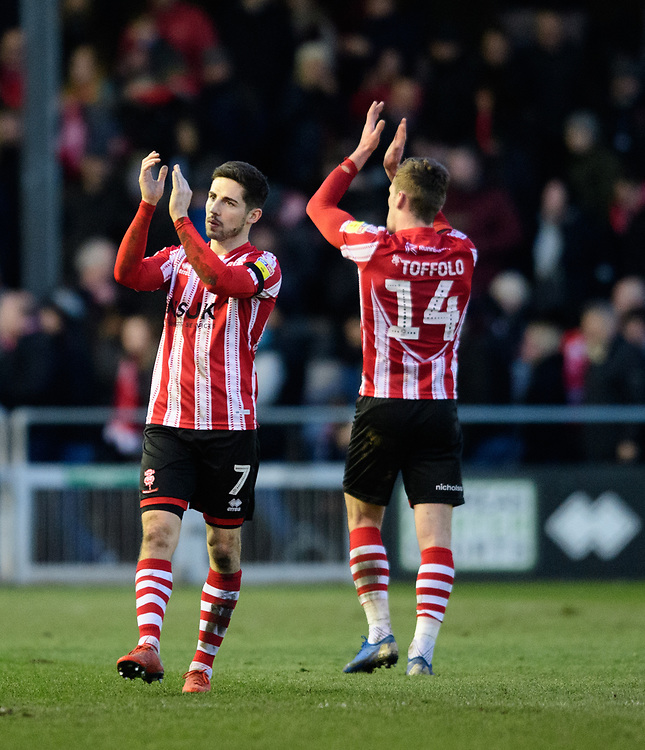 Lincoln City's Tom Pett, left, and Lincoln City's Harry Toffolo applaud the fans at the final whistle<br /> <br /> Photographer Chris Vaughan/CameraSport<br /> <br /> The EFL Sky Bet League Two - Lincoln City v Northampton Town - Saturday 9th February 2019 - Sincil Bank - Lincoln<br /> <br /> World Copyright © 2019 CameraSport. All rights reserved. 43 Linden Ave. Countesthorpe. Leicester. England. LE8 5PG - Tel: +44 (0) 116 277 4147 - admin@camerasport.com - www.camerasport.com