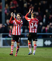 Lincoln City's Tom Pett, left, and Lincoln City's Harry Toffolo applaud the fans at the final whistle<br /> <br /> Photographer Chris Vaughan/CameraSport<br /> <br /> The EFL Sky Bet League Two - Lincoln City v Northampton Town - Saturday 9th February 2019 - Sincil Bank - Lincoln<br /> <br /> World Copyright &copy; 2019 CameraSport. All rights reserved. 43 Linden Ave. Countesthorpe. Leicester. England. LE8 5PG - Tel: +44 (0) 116 277 4147 - admin@camerasport.com - www.camerasport.com