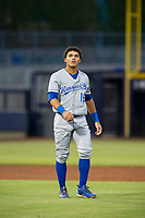 AZL Royals right fielder Jose Caraballo (16) walks off the field between innings of the game against the AZL Mariners on July 29, 2017 at Peoria Stadium in Peoria, Arizona. AZL Royals defeated the AZL Mariners 11-4. (Zachary Lucy/Four Seam Images)