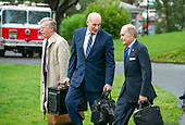 National Security Advisor John Bolton, left, White House Chief of Staff John Kelly, center, and Director of the National Economic Council Larry Kudlow walk across the South Lawn to accompany United States President Donald J. Trump as he departs the White House in Washington, DC on Monday, April 16, 2018.  The President is scheduled to go to Mar-a-Lago where he will meet Prime Minister Shinzo Abe of Japan later in the week.<br /> Credit: Ron Sachs / CNP