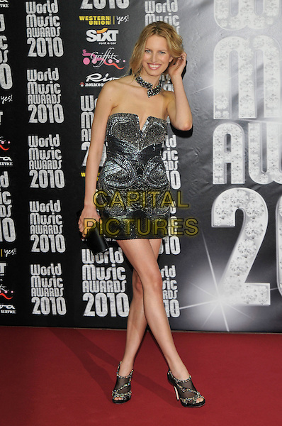 KAROLINA KURKOVA.World Music Awards 2010 at the Sporting Club Monte Carlo, Monaco..18th May 2010 .full length strapless black dress silver necklace choker shooboots booties shoe boots ankle mini hand  .CAP/PL.©Phil Loftus/Capital Pictures.