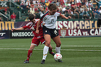 USWNT's Lauren Cheney (19) fights for control against Canada's Diana Matheson (8). The U.S. Women's National Team defeated 1-0 in a friendly match at Marina Auto Stadium in Rochester, NY on July 19, 2009. Abby Wambach of the USWNT scored her 100th career goal in the second half..
