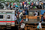 Bangladeshi Muslims try to climb on to the roof of an overcrowded train as they head to their homes ahead of Eid al-Fitr at a railway station in Dhaka, Bangladesh. Hundreds of thousands of people working in Dhaka plan to leave for their home towns to celebrate with their family the upcoming Eid al-Fitr.