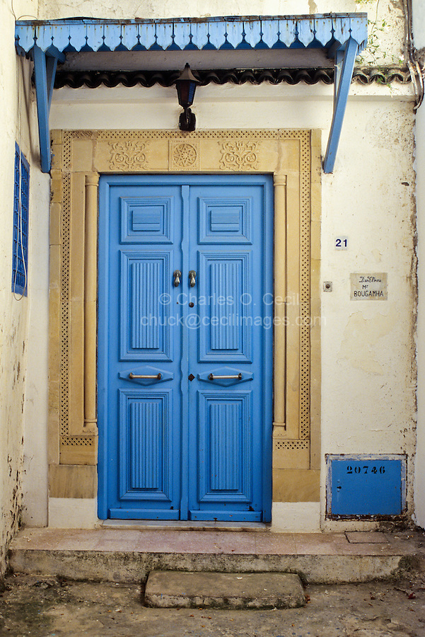 Tunisia, Sidi Bou Said.  Blue Door to Private Home, with Carved Stone Door Frame.