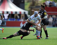 Tom Waldrom of Exeter Chiefs is tackled by Petrus du Plessis of Saracens