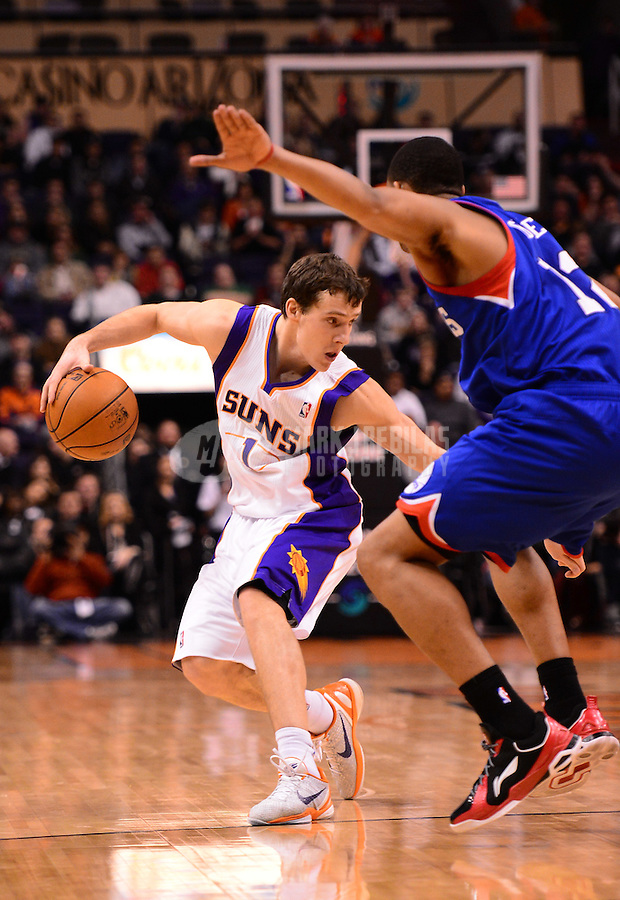 Jan. 2, 2013; Phoenix, AZ, USA: Phoenix Suns guard Goran Dragic (1) controls the ball in the second half against the Philadelphia 76ers at the US Airways Center. The Suns defeated the 76ers 95-89. Mandatory Credit: Mark J. Rebilas-USA TODAY Sports