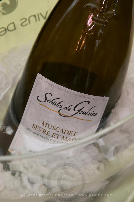 Bottles in ice bucket. Schistes de Goulaine Muscadet Sevre et maine, Chateau la Tarciere, Bonnet Huteau.