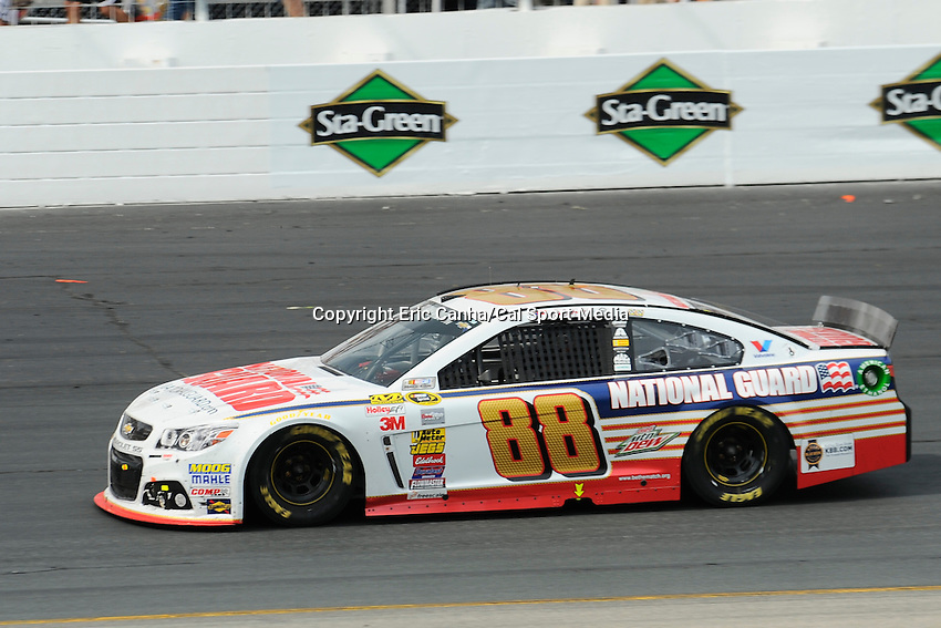 July 13, 2014 - Loudon, New Hampshire, U.S. - Sprint Cup Series driver Dale Earnhardt Jr. (88) goes into turn 4 at the NASCAR Sprint Cup Series Camping World RV 301 race held at the New Hampshire Motor Speedway in Loudon, New Hampshire. Eric Canha/CSM