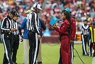 Landover, MD - October 14, 2018: Referee Clay Martin (19) looks at the replay during the  game between Carolina Panthers and Washington Redskins at FedEx Field in Landover, MD.   (Photo by Elliott Brown/Media Images International)