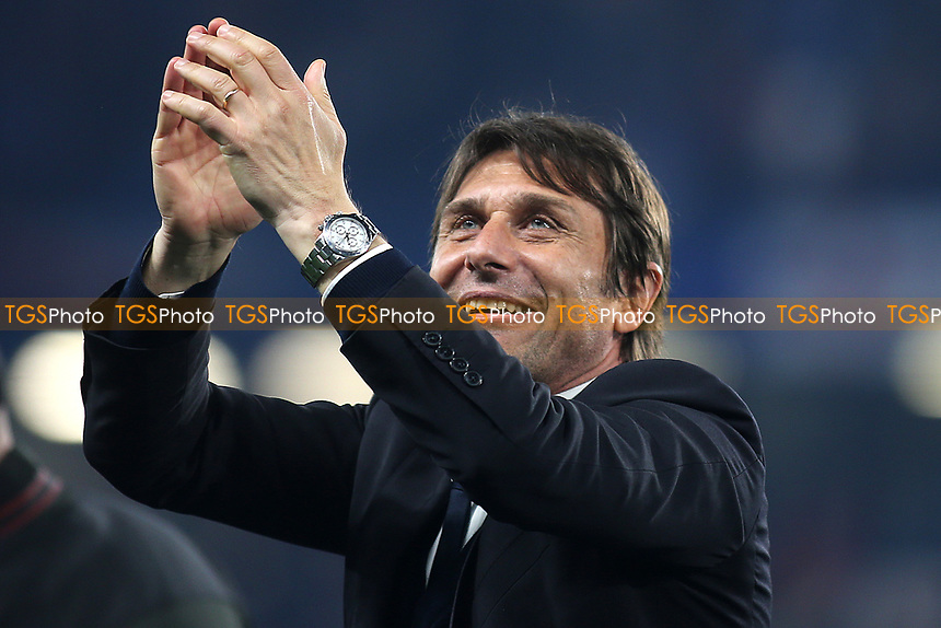 Chelsea Manager, Antonio Conte, applauds the home fans as the players and coaching staff celebrate winning the Premier League with a lap of honour during Chelsea vs Watford, Premier League Football at Stamford Bridge on 15th May 2017