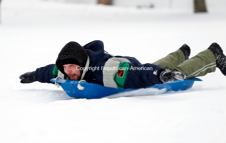 Middlebury, CT- 02 February 2015-020215CM04-  Kirk Mehlin of Watertown sleds down Shepardson Hill in Middlebury on Monday. Mehlin was out enjoying the snow with family, including his wife Lisa, and daughter Hannah and her friend Emily Gursky.  Christopher Massa Republican-American