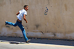 A Palestinian youth uses a slingshot to hurl rocks at (unseen) Israeli soldiers during protests against the expansion of the nearby Jewish settlement of Halamish, in the West Bank village of Nabi Saleh near Ramallah on 02/07/2010.