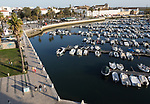 Boats at moorings in the evening marina in the harbour at Faro, Algarve, Portugal