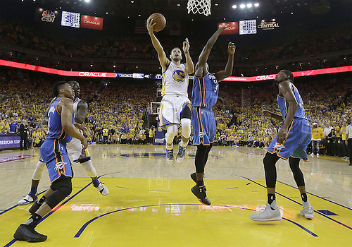 30.05.2016. Oakland, California, U.S - Golden State Warriors guard Stephen Curry (30) shoots against Oklahoma City Thunder forward Serge Ibaka (9) during the first half of Game 7 of the NBA basketball Western Conference finals in Oakland, Calif., Monday, May 30, 2016