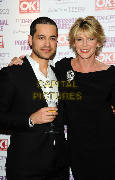 Leo Bancroft & Ruth Langsford.Leo Bancroft range - launch party.celebrity hairstylist launches his latest brand of products at exclusive West End members club, The Club at The Ivy, London, England..April 18th, 2012.half length dress black suit drink beverage stubble facial hair silver brooch.CAP/CJ.©Chris Joseph/Capital Pictures.