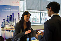 A recruiter at the Singapore booth speaks  with a student.  Engineers and applied science students attend the NYU-Poly Engineering and Technology Spring Career Fair at NYU-Poly in Brooklyn in in New York on February 28, 2013.  The US Labor Department reports new claims for unemployment benefits for last week dropped 22,000 to a seasonally adjusted 344,000.   © Frances M. Roberts)