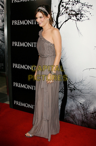 """SANDRA BULLOCK .""""Premonition"""" World Premiere held at the ArcLight Cinerama Dome Theatre, Hollywood, California, USA..March 12th, 2007.full length purple grey gray one shoulder dress silver bracelet pleated.CAP/ADM/RE.©Russ Elliot/AdMedia/Capital Pictures"""