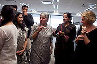 Colleagues share a light moment after the puja (prayer and blessing) ceremony at the opening of the new Bill & Melinda Gates Foundation office in New Delhi, India on 17th December 2010. Photo by Suzanne Lee for Gates Foundation