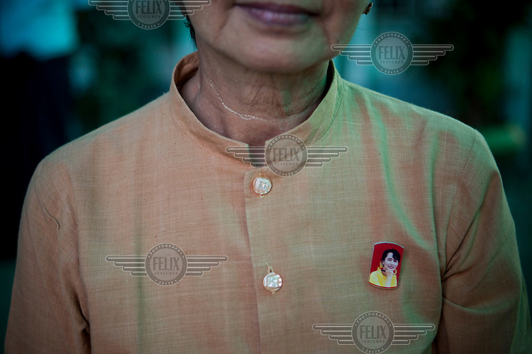 A woman openly wears a badge with Aung San Suu Kyi's face on it in Yangon. A few months earlier she could have been arrested for such an open display of support for the leader of the National League for Democracy (NLD).