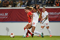 20181005 - LEUVEN , BELGIUM : Belgian Davinia Vanmechelen (L) and Switzerland's Eseosa Aigbogun (19)  pictured during the female soccer game between the Belgian Red Flames and Switzerland , the first leg in the semi finals play offs for qualification for the World Championship in France 2019, Friday 5 th october 2018 at OHL Stadion Den Dreef in Leuven , Belgium. PHOTO SPORTPIX.BE | DIRK VUYLSTEKE