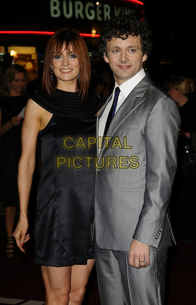"LORRAINE STEWART & MICHAEL SHEEN.World Premiere of ""The Damned United"" at the Vue West End, Leicester Square, London, England..March 18th 2009.half 3/4 length grey gray suit black dress tie couple .CAP/CAN.©Can Nguyen/Capital Pictures."