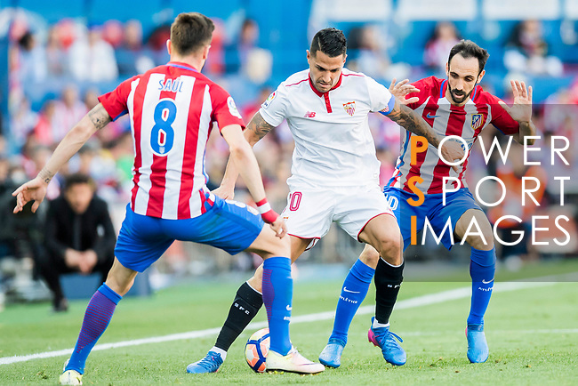 Victor Machin Perez Vitolo (c) of Sevilla FC competes for the ball with Vicente Iborra de la Fuente (l) and Juan Francisco Torres Belen, Juanfran (r), of Atletico de Madrid during their La Liga match between Atletico de Madrid and Sevilla FC at the Estadio Vicente Calderon on 19 March 2017 in Madrid, Spain. Photo by Diego Gonzalez Souto / Power Sport Images