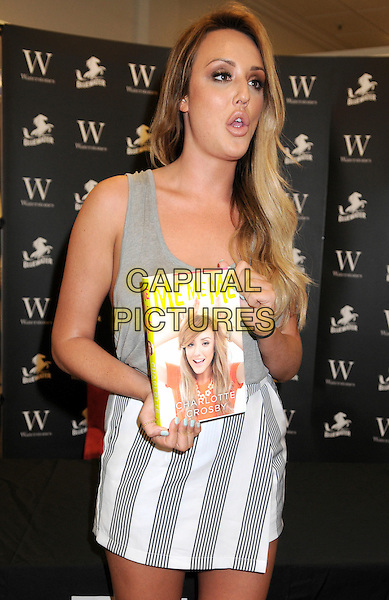 GREENHITHE, ENGLAND - Charlotte Crosby signs copies of her new autobiography, 'Me Me Me' at Waterstones Bluewater Shopping Centre 14th July 2015 in Greenhithe, Kent, England<br /> CAP/BK/PP<br /> &copy;Bob Kent/PP/Capital Pictures