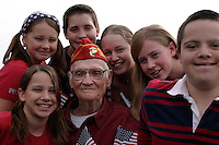 LOS ANGELES,CA - NOVEMBER 11,2009: World War ll Veteran Charles Gordon Hicks, 84, surrounded by 6 of his 12 grandchildren. The sixth annual San Fernando Valley Veterans Day Parade gathered veterans and the people who love them along along Laurel Canyon boulevard, November 11, 2009..(Photo: Spencer Weiner/Los Angeles Times)