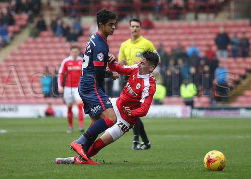 20.02.2016. Oakwell Stadium, Barnsley, England. Skybet League One Barnsley versus Doncaster. Barnsleys Adam Hammill is brought down by Doncasters Cameron Stewart