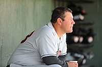 Hagerstown Suns Manager Brian Daubach #23 cools off in the dugout during a game against the Kannapolis Intimidators at Fieldcrest Cannon Stadium in Kannapolis,  North Carolina;  May 30, 2011.  The Intimidators won the game 3-0.  Photo By Tony Farlow/Four Seam Images